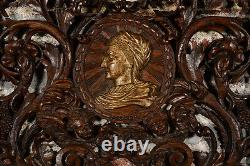 19th century Rococo highly carved wood wall panel withfigural heads